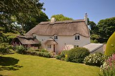 Old Thatch, a beautiful 16th Century thatched cottage overlooking Torcross, and Start Bay, South Devon.    This beautiful holiday cottage can accommodate up to 8 guests and is just a short (but steep) walk down to the beach at Slapton Sands