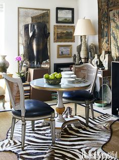 A small dining room doubles as a library, where more of Mayberry's collection is displayed — including an antique bronze Sukhothai Buddha acquired in Bangkok, a vintage zebra-skin rug from London and a lamp made from an antique Chinese burial urn. Dining Nook, Dining Room Design, Dining Table, Dining Chairs, Small Dining, Best Dining, Decoration, Interior Decorating, Decorating Ideas