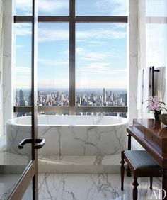 small marble bathroom with city views... Beautiful Bathroom Inspiration: Big City Style