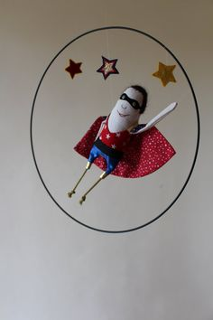 Wallace, our super hero rock & roll, flirts with the stars. This mobile will perfectly find its place in a childs room.    You can discover
