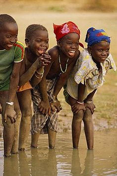 Group of young children smiling, paddling in the Niger River, Mali, West Africa, Africa