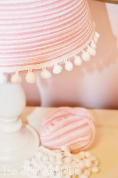Lamp Makeover! - you need a lamp base, lamp shade, some yarn, an embellishment strip like these pompons, spray paint and spray glue