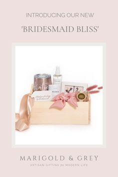 """Spoil your bridal party with these luxe wood boxes filled with unique items they'll love and remember you for! Our signature 'Bridesmaid Bliss"""" will definitely have them talking, but don't worry, in a good way! You can even personalize the Swig-brand tumbler and/or gift tags to reflect each bridesmaid's first name for that added personal touch! (Minimum of 4 gifts required for personalization.)"""