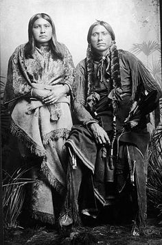 Last great chief of the North American Comanche indian tribe Quanah Parker (c. 1840 - 1911) sits and poses for a photograph with one of his eight wives after his capture, Fort Sill, Oklahoma, June 22, 1875. Parker, the son of captive woman Cynthia Ann Parker, led raids on settlements in Texas from 1867 to 1875. After capture he became rich as the business manager for the Comanche, Kiowa, and Apache tribes.