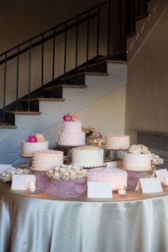 When I was at Engage 2011, Sylvia Weinstock said that the cake is the one true centerpiece of the wedding. Well in the case of this next pretty little wedding, it's the cakes (plural) that have completely stolen my heart. And the