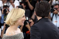Let us in on the joke! Sienna looked enthralled at something her Cannes colleague had to s...