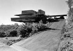 The George Sturges House was designed by architect Frank Lloyd Wright and built in 1939 at 449 North Skyewiay Road in the Brentwood Heights neighborhood of Los Angeles, seen here in a 1947 photograph by Pedro Guerrero. Wright hired Taliesin fellow John Lautner to oversee its construction. It inspired the mountaintop residence in NORTH BY NORTHWEST. Sturges House is the only structure in Southern California built in the modern style Wright called Usonian design. It remains a private residence, which was owned by the late actor Jack Larson until his death in September 2015.