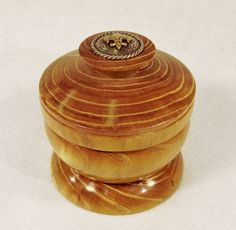"This is a lathe turned lidded vessel known as a salt cellar.  It is kept close to the chef's side and used when just a pinch of salt is enough.  It is made of Bois D'arc and is polished to a high luster inside and out.  No finish was applied.  It has a silver medallion inlaid on top for accent.  It is approximately 4"" x 4"".  Completed 9-2014."