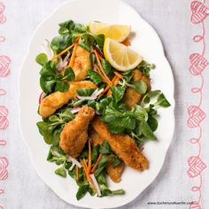 Salad topped with breaded chicken - Backhendlsalat