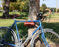 Especially when you need to take wine on the road, this Bicycle Leather Wine Bottle Carrier is just perfect