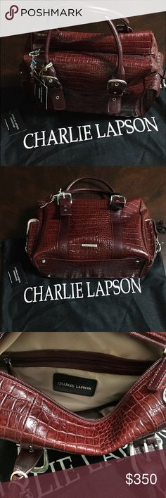 "Authentic NWT Charlie Lapson Burgundy Leather Bag Authentic NWT Charlie Lapson Burgundy Croc Embossed Leather Bag - 14""L x 8""W x 9""H - Adjustable Strap Length Buckles - Purse Feet - Inside Pockets & Zipper Compartments - Outside Buckled Pockets - Jeweled Zipper Pull - Silver Hardware - Sleeper Bag - Working with celebrities across all genres & spectrums of the entertainment industry, Charlie Lapson has accessorized & styled the most prolific & influential talent in Hollywood. His trademark…"
