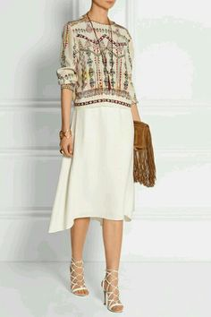 6f21cbacf66 Erto s print skirt and blouse easily lend themselves to mixing and matching  with other separates in