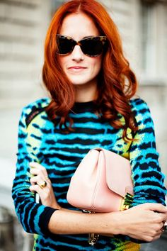 taylor tomasi hill in a proenza schouler tie-dyed animal print top.