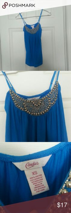 PRICE DROP Blue tank top with beading You can be cool and look hot this summer with a Brand new blue spaghetti strap shirt with metallic beading  adjustable straps Tops Tank Tops