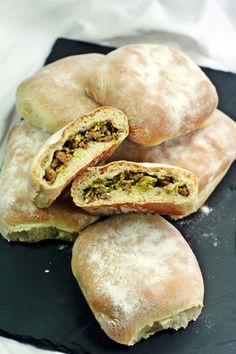 Bierocks - White dough rolls baked with a filling of minced beef, cabbage and onions.