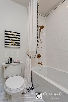 Penny round flooring, subway tile, brass fixtures and Pom Pom trim