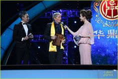 Receiving a Lifetime Achievement Award at the 14th Huading Music Awards in Shanghai, China on 8th January, 2015.