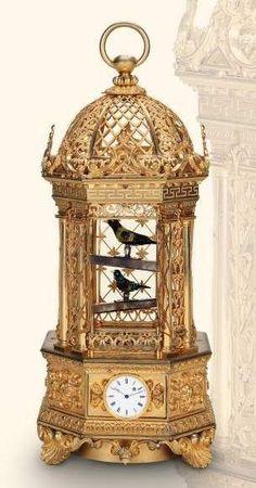 Fine and rare gilt bronze singing bird cage with two birds and watch. Attributed to Charles Abraham Bruguier, Geneva, circa 1840./ via antiqueclockspriceguide.com