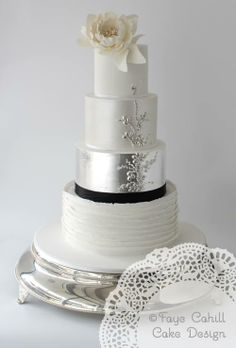 4 tier cake with ruffles, silver leaf and edible beading by Faye Cahill Cake Design