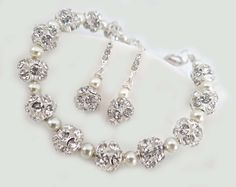 Bridal drop dangle earrings and rhinestone bracelet jewelry set  This gorgeous shimmering set features rhinestone pave bling balls and 4mm crystallized cream pearls The bra... #brides