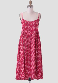 The perfect summer frock, this breezy red midi dress features an allover floral print in hues of white and light blue and button closures down the front. Finished with adjustable straps and subtl...