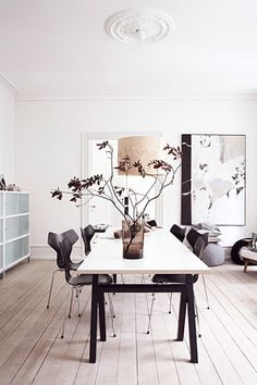 Maison danoise : Dining room table by SUP Design (from Design Nation), with Arne Jacobsen's Grand Prix chairs from Aram. The smoky vase is from By Nord, and the birch pendant by Cathrine Kullberg is from Heal's. Scandinavian Living, Scandinavian Interior, Home Interior, Interior Architecture, Interior Decorating, Design Interior, Modern Interior, Decorating Ideas, Decor Ideas