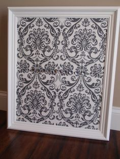 Framed Magnetic Bulletin Board / Photo Display / Nursery Decor - Gray & White Damask Fabric, White Distressed Frame, Ten Jewel Magnets. $52.00, via Etsy.