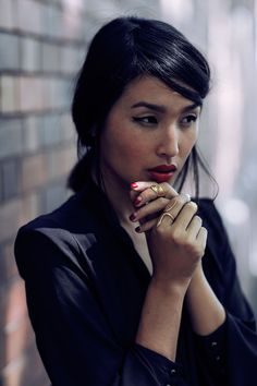 cat eye, red lips, and reversed french manicure. Nicole's a beauty