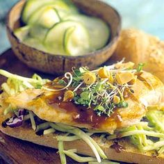Spicy-sweet peanut sauce and crisp broccoli slaw lend Asian flavors to this grilled chicken breast sandwich recipe that goes from grill to table in 15 minutes.