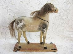 Antique Stick Legged Horse on Platform Wheels SOLD