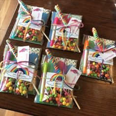 """Trolls birthday party favors. Dollar store trolls notebooks and markers, DIY Skittles """"Rainbow seeds"""", and rainbow lollipops"""