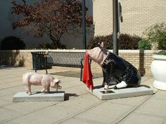 # 18 of the 2004 Pigs in the City II, of Lexington, NC. (Pork BBQ Capital of the World). Was sponsored by Don Juan's Mexican Restaurant, and the artist was Jan Fritts. It was located on N. Main St. in front of the Police Dept.