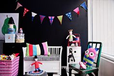 dark walls with bright decor is an interesting idea for a kids room that has a lot of natural light.