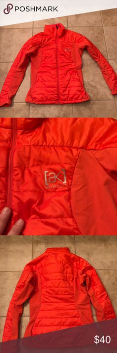 Burton AK Helium Insulator Ski Boarding jacket S Great used condition juniors snowboarding jacket. Burton brand. Orange in color. Style is AK Helium Insulator.  Down over body and streachy matching fabrics on sides and under sleeves for stretch. Minor wear in the stretchy area. One minor stain on bottom of left sleeve. See pic. Cut the size tag out. Please go by measurements since tag is missing . Fits slim and is probably a small or XS. Burton Jackets & Coats