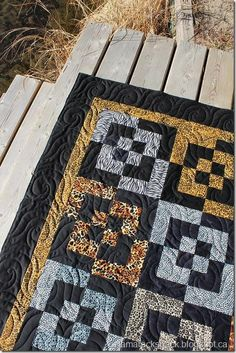 This is Melba's Bento Box quilt and she used animal print fabrics with a black background. Now I'm not usually drawn to animal prints . Longarm Quilting, Machine Quilting, Quilting Projects, Quilting Designs, Quilting Ideas, Art Quilting, Sewing Projects, Black And White Quilts, Quilt Of Valor