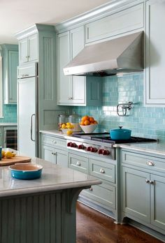 Beautiful soft blue cupboards with stunning backsplash of blue subway tiles