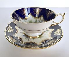 Vintage Paragon china tea cup and saucer, made in England. A beautiful cobalt floral cabinet duo with lots of gold gilding on both the inside of the cup and on the saucer. It is in good condition, no chips, cracks or crazing. Please Note: The items I sell are not new, they
