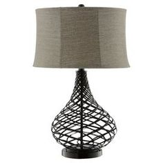 "Gourd-shaped table lamp with an open weave design and textured natural shade.     Product: Lamp   Construction Material: Metal and fabric   Color: Dark beige and black  Features: Textured natural round shade   Will enhance any decor Accommodates: (1) 150 Watt 3-way base bulb - not included  Dimensions: 28"" H x 18"" Diameter"