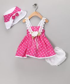 Lots and lots of polka dots! We could stop there but then how would we describe the beautiful rose pin at the waist, the lace straps and snap-button back, the playfully puffy skirt and that darling bonnet?Includes dress, diaper cover and bonnet100% polyester