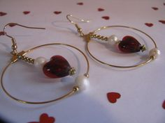Pearl and Heart Dangling Hoops by ROOTSJewelryandGifts on Etsy