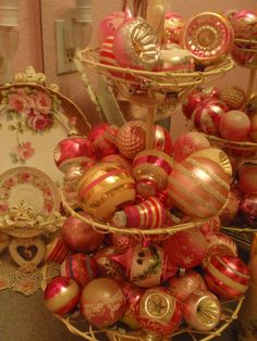 Vintage pink Christmas ornaments in tiered wire basket