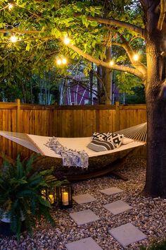 Backyard Hammock, Hammocks, Patio Hammock Ideas, Lights In Backyard, Sloped Backyard, Outdoor Hammock, Backyard Play, Backyard Lighting, Small Backyard Landscaping