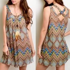"""Beautiful Crisscross Back Dress/Tunic FEATHER NECKLACE NOT INCLUDED!  Diamond & chevron print dress in gorgeous, classy colored print. V'd crisscross back. Fully lined. Approximate 30"""" length. Brand new retail w/o tags. No trades, no holding, no offline/App transactions.      🗣PRICE IS FIRM UNLESS BUNDLED                 💙 5% off bundles 💚 Dresses Mini"""