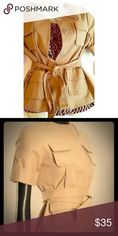 Michael Kors safari jacket Cotton stretch, short sleeve, belted, khaki colored, collarless! One year old, purchased at Macy's, used but good condition. MICHAEL Michael Kors Jackets & Coats Blazers