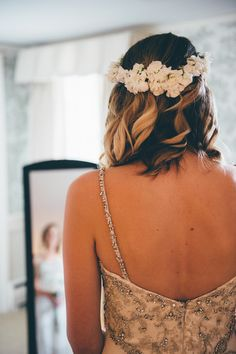 Casual wedding day hairstyle for short hair - short, curly hair with white flower crown {Bryan Sargent Photography}