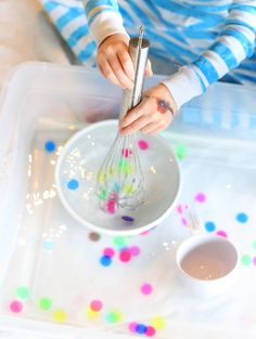 Water Sensory Play: Polka Dot Soup from Fun at Home with Kids. Use bingo chips or cut circles out of foam Autism Activities, Sensory Activities, Craft Activities For Kids, Sensory Play, Infant Activities, Preschool Crafts, Crafts For Kids, Cognitive Activities, Babysitting Activities