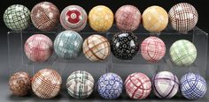 STAFFORDSHIRE POTTERY CARPET BALLSA COLLECTION OF NINETEEN STAFFORDSHIRE POTTERY CARPET BALLS, 19TH CENTURY. Of various size and decoration. The largest diameter 3.5 inches, together with a carved granite sphere.