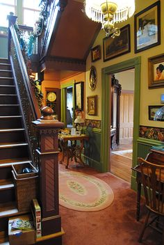 """A view of our Folk Victorian hall from front to back. My husband designed and installed the staircase. The house didn't originally have one. There is a """"before"""" pic above I just posted."""