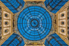 Fifth image in a row containing #round. It is a Magic roof in a Shopping Mall. At first, it seems, that a shoppings mall is a silly place to go looking for great photos, but I have been to a couple, that definitely has been worth photographing. In Milan there is the 'Galleria Vittoria Emanuelle II', and it is absolutely amazing. The two most amazing shopping malls I have seen are both old, and both dates back to the 19th century. Photo by: Jacob Surland, www.caughtinpixels.com Licensed…