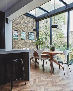 home accents kitchen Stunning modern kitchen with glass enclosed eating area, light oak floors, and exposed brick wall Open Plan Kitchen Dining, Home Interior Design, House Design, Decor, Open Plan Kitchen, Home, Modern Kitchen, Light Oak Floors, Kitchen Extension